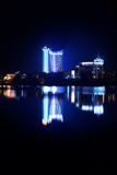Reflection of a night city in water. Minsk. Stock Photo