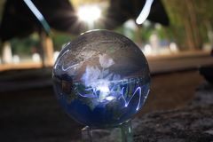 Reflection of a night scape. Throught a crystal ball witha a blured background Royalty Free Stock Image