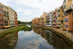 Girona, Catalonia, Spain, The dark waters of the river with the reflection of the surrounding buildings. royalty free stock images