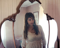 Reflection Of Beautiful Young Woman In Mirror Stock Photography