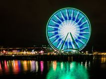 Free Reflection Of The Lights On The Ferris Wheel On The Coastline Of Seattle, USA At Night Stock Images - 163006194
