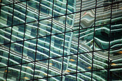 Reflection of an office block skyscraper. In glass windows Royalty Free Stock Photography