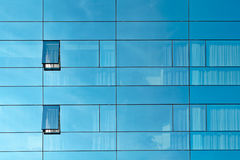 Reflection in an office building glass wall Royalty Free Stock Image