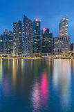 Reflection of office building during twilight in Marina Bay Singapore Royalty Free Stock Photography