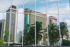 Reflection of the office buildings in the modern building windows in Kuala Lumpur, Malaysia. Royalty Free Stock Image
