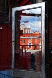 Reflection of old building in glass door on Off Piotrkowska in L Stock Image
