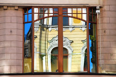 Reflection of old building in window in Lodz Stock Photos
