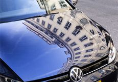 Lisbon Reflection on Bonnet. Reflection of old buildings on a car bonnet in Lisbon, Portugal Royalty Free Stock Photos