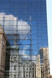 Reflection. Old buildings reflectd in modern glass building Stock Photos