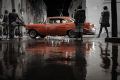 Reflection of an old car. In a puddle in the streets of Trinidad Stock Photo