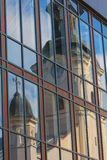 Reflection of an old church in the facade of a modern building. Architectural abstraction Royalty Free Stock Photo