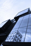 Reflection of old house in glass of new building Stock Images