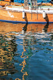 Reflection of an old sailing boat in the water Royalty Free Stock Photos