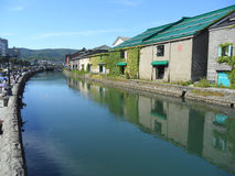 Reflection of The Old Warehouse along Otaru Canal, the Famous Attraction in Otaru Town Stock Photo