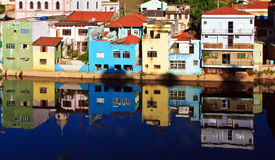 Reflection of Painted House in River Stock Image