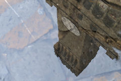Reflection of Palazzo Vecchio. Reflection of the tower of Palazzo Vecchio in a pool on piazza della Signoria in Florence, Italy, after heavy rains had emptied stock photography