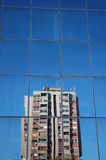 Reflection Of The Past. An older building reflecting off the new one stock image