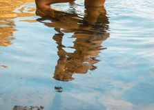 Reflection of a person`s body in the water. Photo taken in a lake Royalty Free Stock Photos