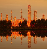 Reflection of petrochemical industry. Reflection of petrochemical industry on sunset stock image