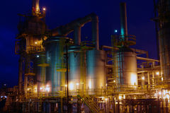 Reflection of petrochemical industry on sunset dar Stock Photography