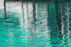 Reflection of a pier in the waters of lake Royalty Free Stock Photos
