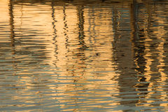 Reflection of a pier in the waters of lake Stock Photo