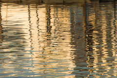 Reflection of a pier in the waters of lake Stock Photos