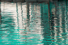 Reflection of a pier in the waters of lake Royalty Free Stock Photo