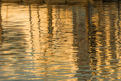 Reflection of a pier in the waters of lake Stock Photography