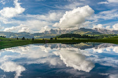 Reflection on a pond in the Dolomites. Italy royalty free stock photos