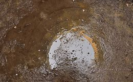 Reflection in a pool of water. Reflection of the inside of a abandoned cooling tower in a pool of water Stock Photos
