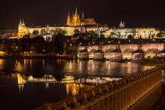 Reflection of Prague caste and the Charles bridge at dusk Royalty Free Stock Images