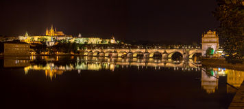 Reflection of Prague caste and the Charles bridge at dusk. Beautiful capital city of Czech Republic Stock Photography
