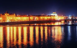 Reflection of Prague caste and the Charles bridge at dusk. Stock Photo