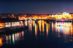 Reflection of Prague caste and the Charles bridge at dusk. Royalty Free Stock Images