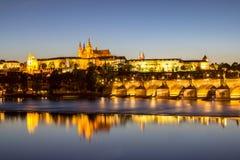 Prague castle and the Charles bridge at dusk. Reflection of Prague castle and the Charles bridge at dusk Royalty Free Stock Photography
