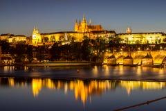 Prague castle and the Charles bridge at dusk. Reflection of Prague castle and the Charles bridge at dusk Stock Images