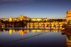 Prague castle and the Charles bridge at dusk. Reflection of Prague castle and the Charles bridge at dusk Stock Photography