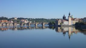 Reflection of prague city panorama in the calm river vltava Stock Photo