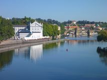 Reflection of prague city panorama in the calm river vltava Stock Images