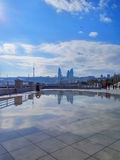 Reflection in puddle after rain on the Baku Boulevard Royalty Free Stock Photography