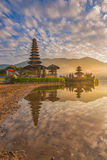 A reflection of a pura temple at sunrise - Pura Ulun Danu Bratan Stock Images
