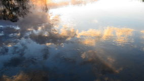 Reflection in a quiet river stock video