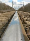 The reflection in the rail Stock Image