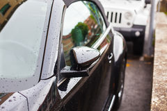 Reflection and raindrops on the car. Royalty Free Stock Images