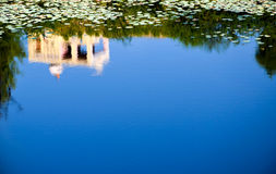 Reflection, Rajasthan, India. House reflection in deep blue water Stock Images