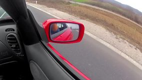 Reflection in a rearview mirror Stock Photography