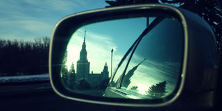 Reflection In A Rearview Mirror. Moscow State University building. Stock Images
