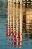 Reflection of red flags in water Royalty Free Stock Image