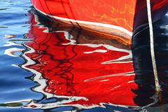 Reflection of a red rowing boat Stock Photo